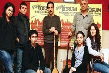 Members of Grup Yorum and fashion designer Şansal released