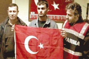 Arrest warrant issued for journalists over exposing Dink's murderer with Turkish flag