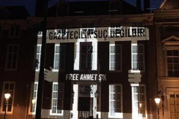 Amnesty projects names of jailed journalists on Turkish Embassy building in the Hague