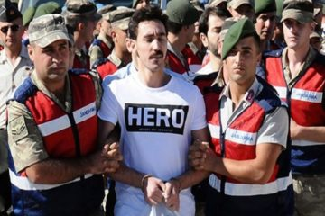 Turkish coup suspect wearing 'hero' T-shirt in trial thrown out of courtroom