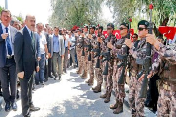 Safeties installed on automatic rifles of Turkish police officers during minister's visit